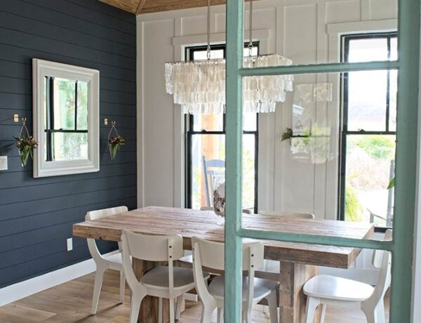 farmhouse dining room, navy blue wall, shiplap, chandelier, wood dining table, west elm, wall vase, white mirror, board and batten, white dining chairs