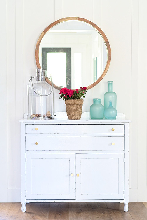 farmhouse, cottage, antique buffet, round wood mirror, beach glass vase, pottery barn candle lantern, gold knobs, brass hardware