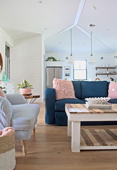 farmhouse living room, ikea sofa, ikea armchair, navy blue sofa, blush pink pillow, shiplap, farmhouse kitchen, wood flooring, coffee table