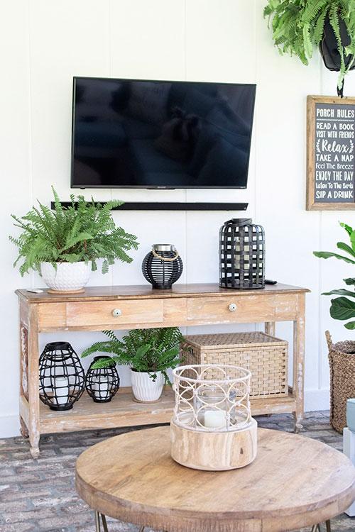 boho style porch, outdoor furniture, hanging plants, white farmhouse