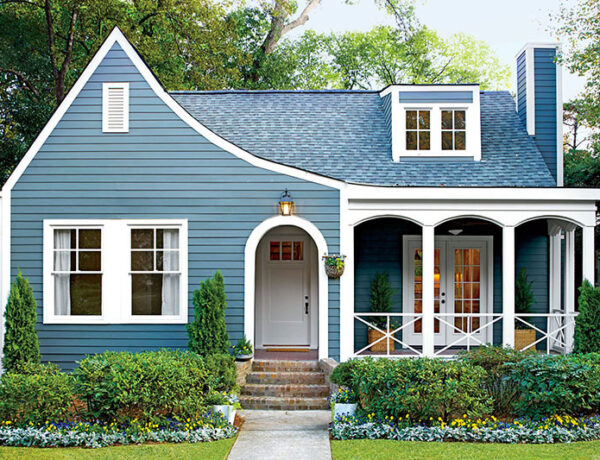 blue cottage house with front porch sherwin williams benjamin moore behr paint