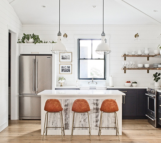 modern farmhouse kitchen with Stikwood on island, and dark navy blue cabinets and exposed wood shelving with shiplap backsplash