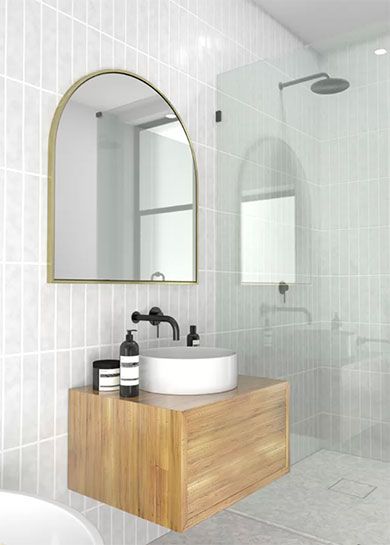 gold brass arched mirror on white tile bathroom tile wall above wood wall and black faucetvanity