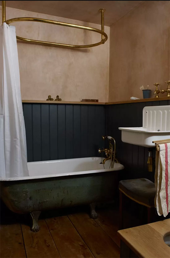 lime wash walls in small bathroom with vintage tub and bucket sink
