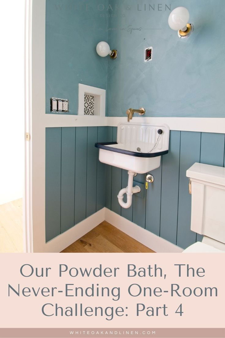 midtone blue powder bath with color wash lime wash walls and shiplap wainscoting antique reproduction bucket sink
